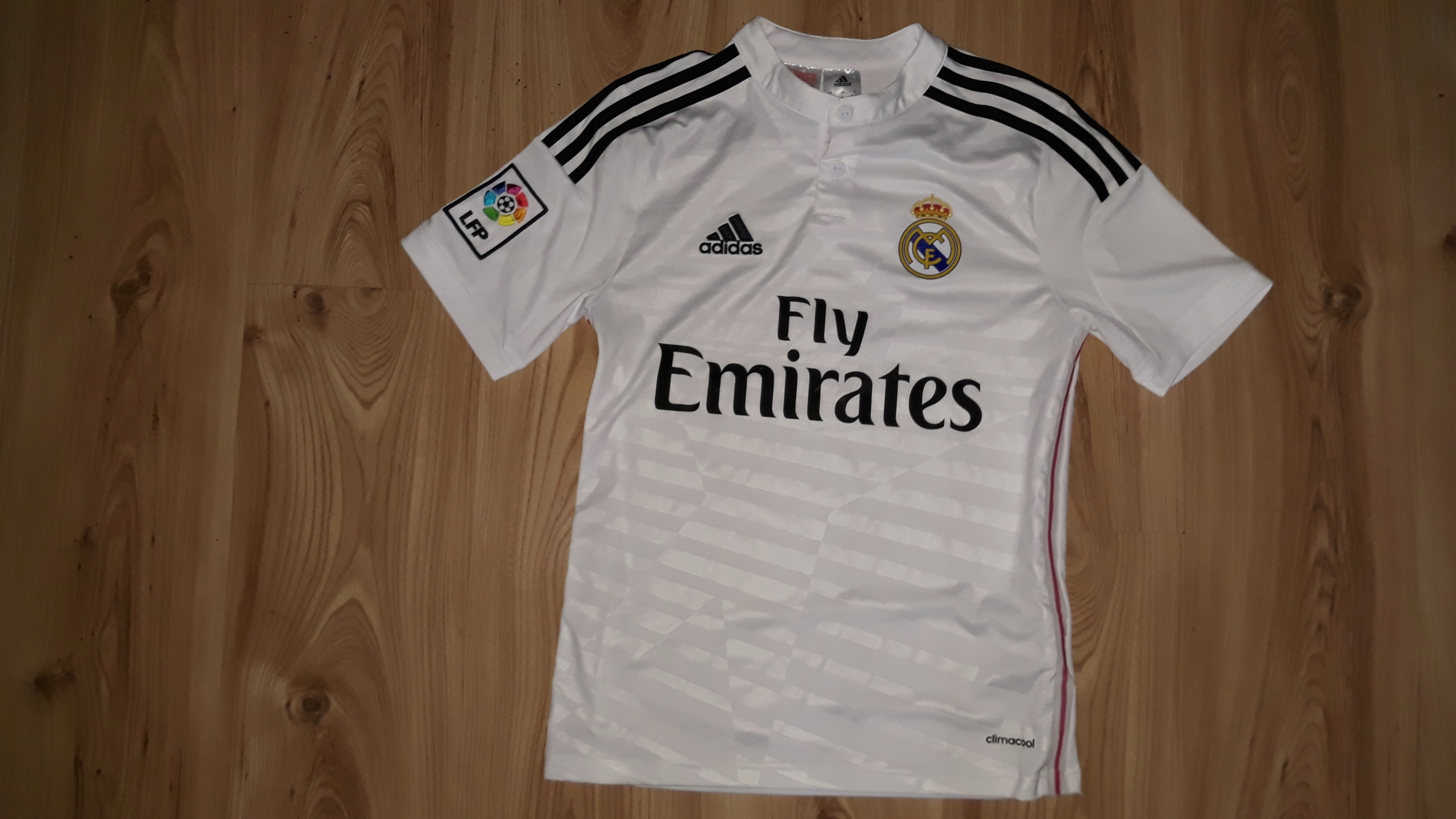 0d557f97b82bf2 Koszulka Adidas Real Madryt L 164 Fly Emirates - 7661528790 - oficjalne  archiwum allegro